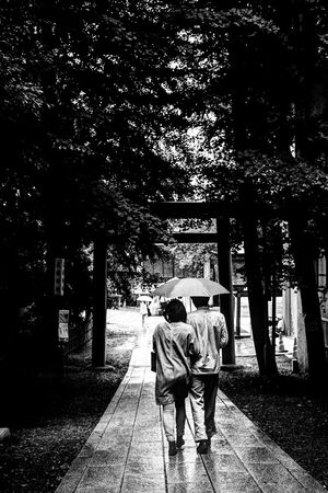 Couple under same umbrella