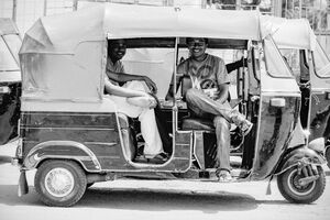 Men chatting on auto rickshaw