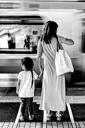 mother and girl on the platform