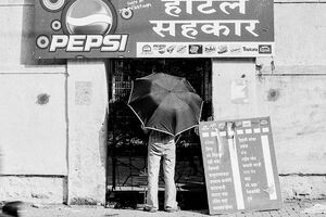 Umbrella in front of shop
