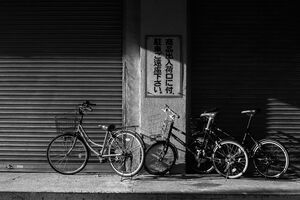 bicycles in front of shutter