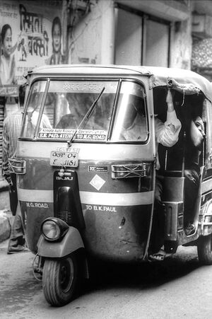 auto rickshaw in lane