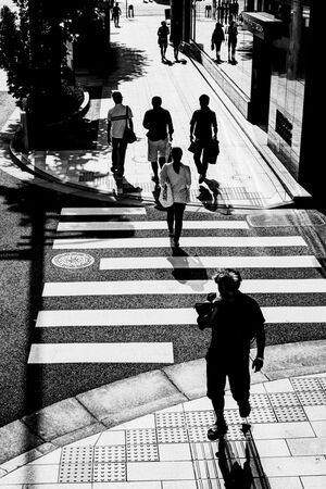 Silhouettes on sidewalk
