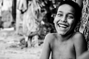 boy laughing from ear to ear