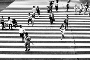 Pedestrians crossing wide street