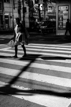 Woman walking pedestrian crossing
