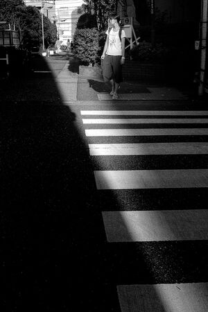 Girl waiting for traffic light
