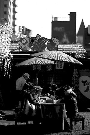 People eating under umbrella
