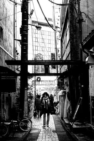 Woman under Torii