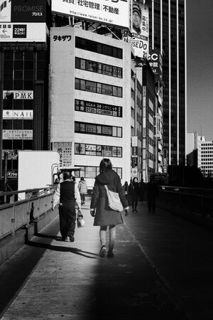 Woman on pedestrian bridge