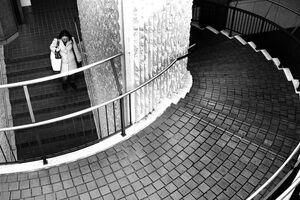 Woman descending spiral stairway