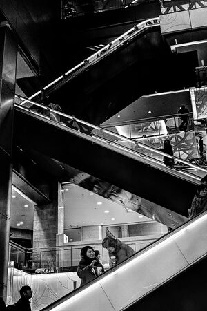 Two women on escalator
