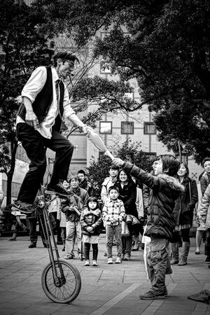 Boy and street performer