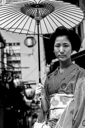 woman holding coarse oilpaper umbrella