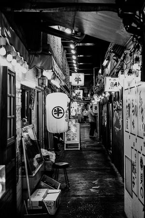 Lanterns and signboards in passage