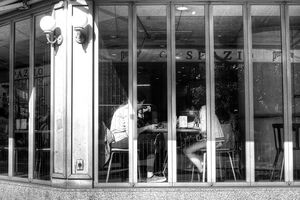 two girls sitting in cafe