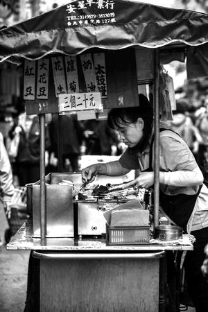 Woman working in Food stall