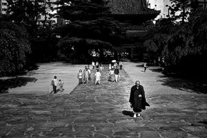 Buddhist monk walking precinct