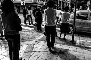 Pedestrians standing by roadside