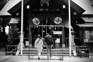 Young couple in Tsukiji Namiyoke Jinja