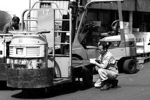Man repairing turret truck
