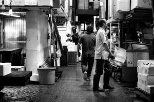 Men walking passage in Tsukiji Market