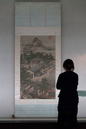 Woman watching wall scroll