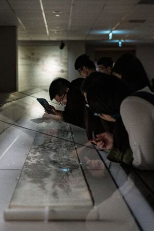 People watching scroll in National Palace Museum