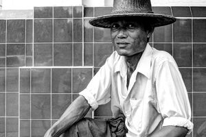 man wearing a rattan hat