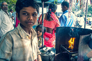 Boy working in Chai stand and his little sister