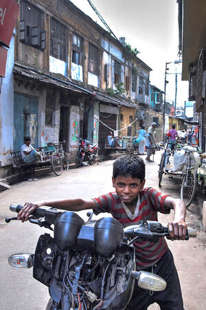 Boy walking motorcycle