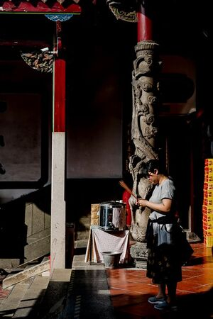 Praying woman in Da Tian Hou Gong