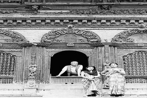 Three persons standing in Shiva-Parvati temple