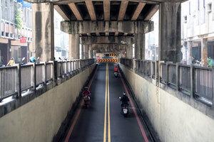 street under bridge over railway