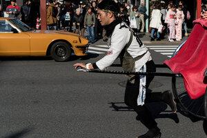 Rickshaw man and supercar