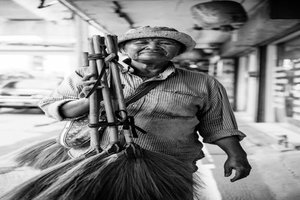Female broom seller