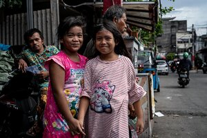 Two smiling girls in Jakarta