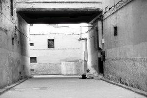 Figure in narrow alley