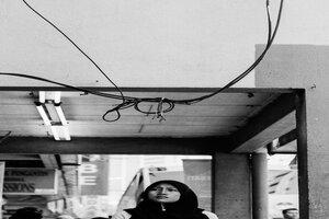 Woman with a hijab walking passage way