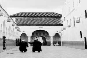 Men entering into Mausoleum