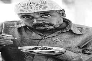 Man holding spoon
