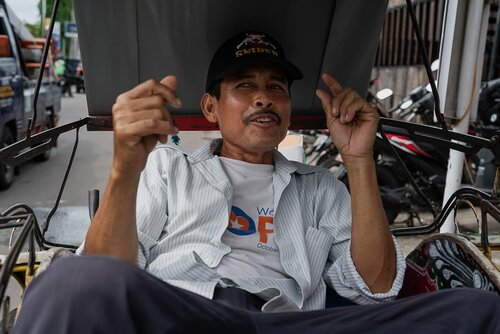 Becak driver with mustache
