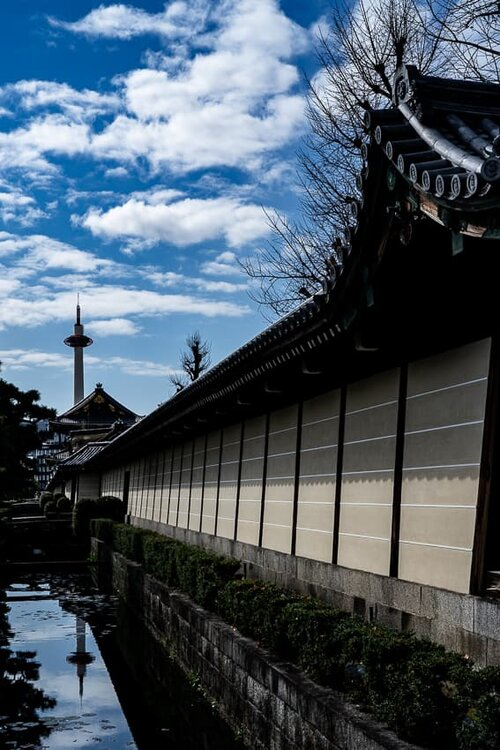 Kyoto Tower reflected in the moat