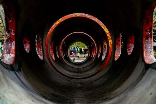 Boy who appears to be at the end of a long, thin tube