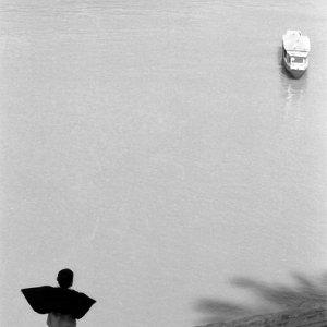 Boy watching ship setting sail