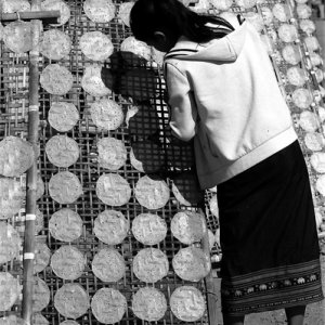 Girl drying rice cakes