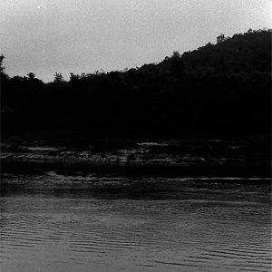 メコン川を進む木製のボート