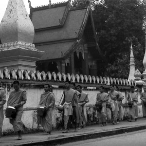 Buddhist monks carrying alms bowl
