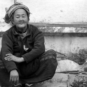 Oder woman working in morning market in Luan Prabang