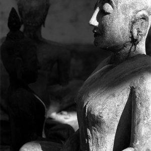 Statue slipping into meditation
